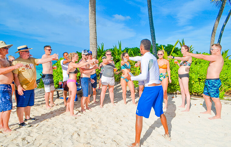 Breakers staff member entertaining a group of people on a pretty tropical island