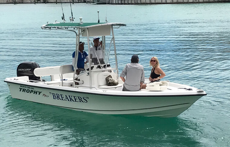 Breakers boat with 4 people on it on the water